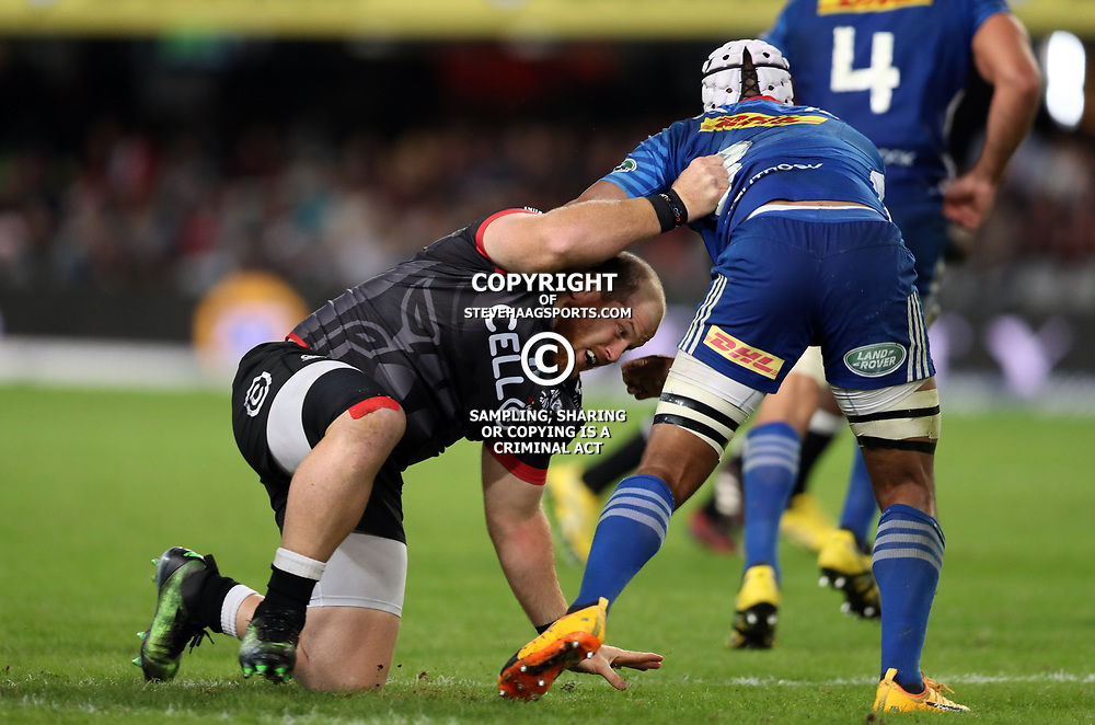 DURBAN, SOUTH AFRICA - MAY 27: Lourens Adriaanse of the Cell C Sharks has hold of Nizaam Carr of the DHL Stormers during the Super Rugby match between Cell C Sharks and DHL Stormers at Growthpoint Kings Park on May 27, 2017 in Durban, South Africa. (Photo by Steve Haag/Gallo Images)