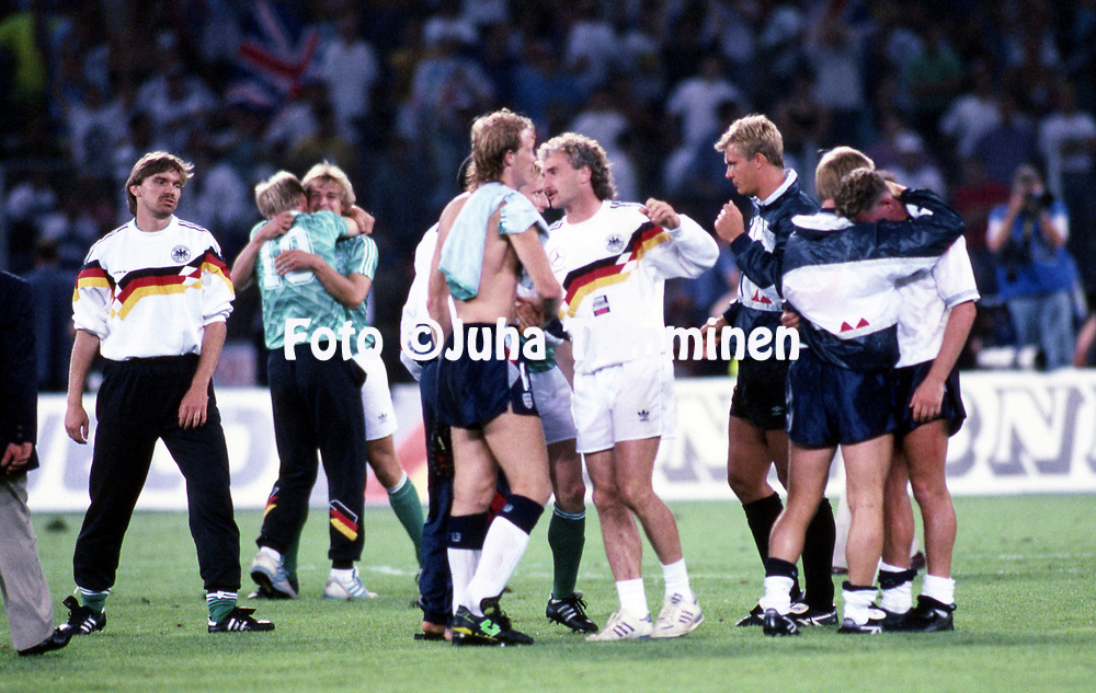FIFA World Cup - Italia 1990<br /> 4.7.1990, Stadio Delle Alpi, Turin, Italy.<br /> Semi-final West Germany v England.<br /> England's Paul Gascoigne crying on the shoulder of Cary Stevens after the defeat. In the middle Mark Wright &amp; Rudi V&ouml;ller.