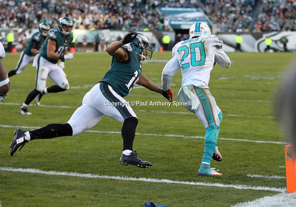 Miami Dolphins strong safety Reshad Jones (20) is chased by Philadelphia Eagles wide receiver Miles Austin (19) after intercepting a pass in the end zone from Philadelphia Eagles quarterback Mark Sanchez (3) with less than five minutes left in the fourth quarter, stopping a scoring drive deep in Miami Dolphins territory, during the 2015 week 10 regular season NFL football game against the Philadelphia Eagles on Sunday, Nov. 15, 2015 in Philadelphia. The Dolphins won the game 20-19. (©Paul Anthony Spinelli)