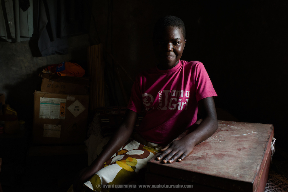 Joan Nyachwo (13), pictured on 2 August 2014, keeps her Afripads in a metal trunk of her belongings at her home near Tororo, Uganda.