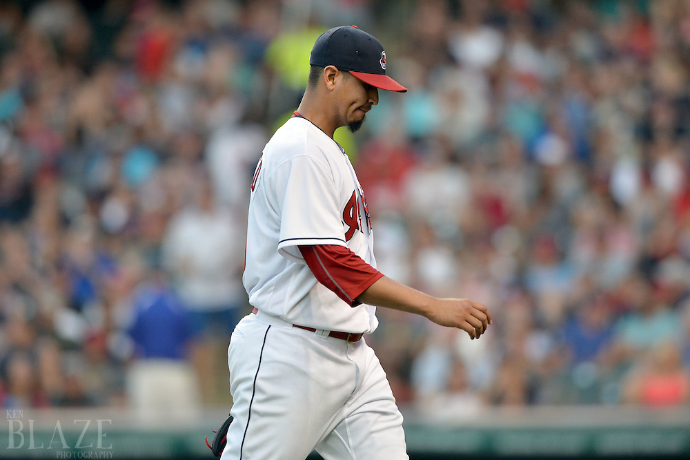 Aug 2, 2016; Cleveland, OH, USA; Cleveland Indians starting pitcher Carlos Carrasco (59) leaves the field during the fourth inning after giving up eight runs to the Minnesota Twins at Progressive Field. Mandatory Credit: Ken Blaze-USA TODAY Sports