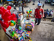 03 AUGUST 2017 - SUKAWATI, BALI, INDONESIA: A toy vendor in the market in Sukawati. Bali's local markets are open on an every three day rotating schedule because venders travel from town to town. Before modern refrigeration and convenience stores became common place on Bali, markets were thriving community gatherings. Fewer people shop at markets now as more and more consumers go to convenience stores and more families have refrigerators.    PHOTO BY JACK KURTZ
