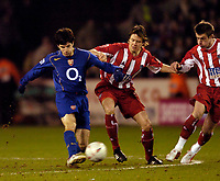 Photo. Jed Wee, Digitalsport<br /> Sheffield United v Arsenal, FA Cup 5th Round Replay, 01/03/2005.<br /> Arsenal's Francesc Fabregas (L) tries to thread a pass through against Sheffield United's Leigh Bromby.