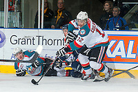 KELOWNA, CANADA -FEBRUARY 1: Tyrell Goulbourne #12 of the Kelowna Rockets recovers the puck from Tyson Baillie #24 after he is checked to the ice by a player of the Kamloops Blazers on February 1, 2014 at Prospera Place in Kelowna, British Columbia, Canada.   (Photo by Marissa Baecker/Getty Images)  *** Local Caption *** Tyrell Goulbourne; Tyson Baillie;