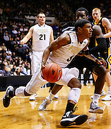 WEST LAFAYETTE, IN - JANUARY 27: Ronnie Johnson #3 of the Purdue Boilermakers dribbles along the baseline against the Iowa Hawkeyes at Mackey Arena on January 27, 2013 in West Lafayette, Indiana. Purdue defeated Iowa 65-62 in overtime. (Photo by Michael Hickey/Getty Images) *** Local Caption *** Ronnie Johnson