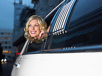 Woman in back of limousine looking out of window