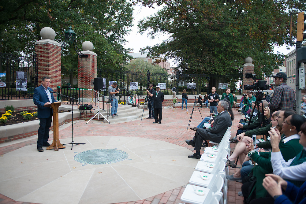Steve Patterson, mayor of Athens, Ohio, speaks with crowds about making the community more accessible during the ribbon-cutting ceremony for Ohio University's newly-renovated College Gateway on October 8, 2016.