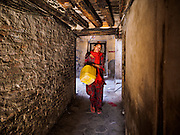 06 MARCH 2017 - KATHMANDU, NEPAL: A woman walks to the public well to get water for her home in Kathmandu.      PHOTO BY JACK KURTZ