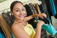 Girl Looking at Purse in Boutique portrait