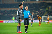 Yellow card for Millwall Midfielder Ben Marshall (44) during the EFL Sky Bet Championship match between Hull City and Millwall at the KCOM Stadium, Kingston upon Hull, England on 26 February 2019.