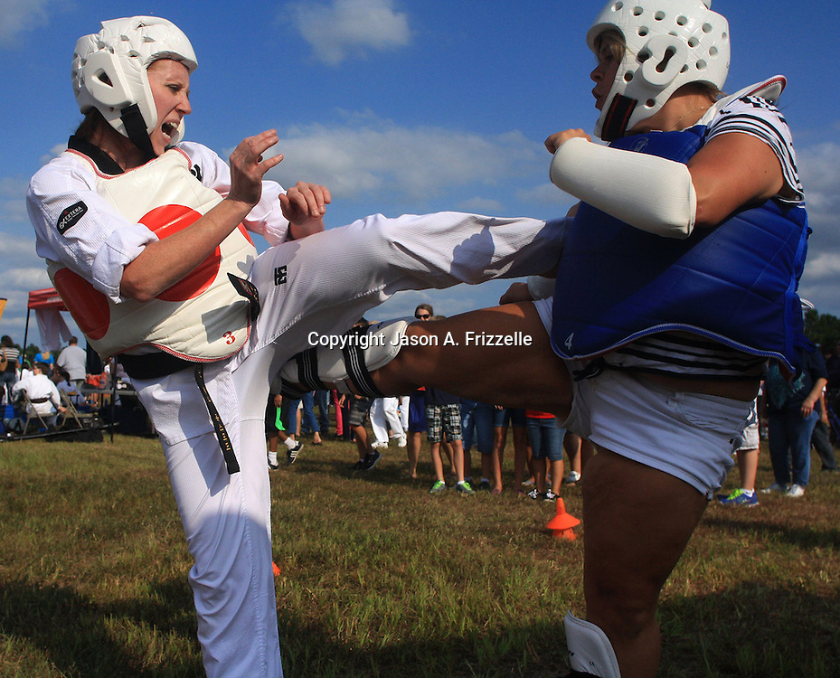 Sarah Oxford, left, and Ashlee English of King Tiger Taekwondo demonstrate martial arts during the Town of Leland's Founder's Day Saturday September 14, 2013. (Jason A. Frizzelle)
