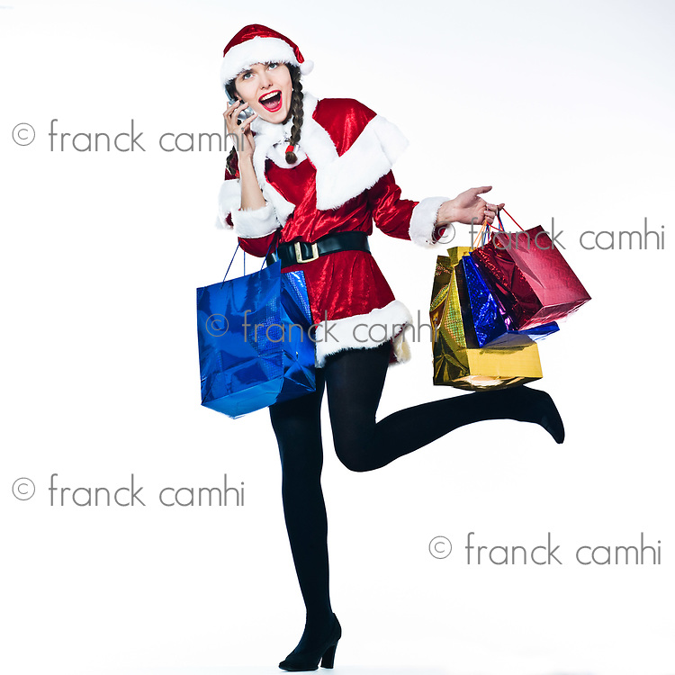 young funny and expressive woman santa claus Christmas Shopping on the phone on studio isolated white background