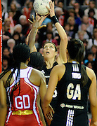 Irene Van Dyk shoots, during New World Netball Series, New Zealand Silver Ferns v England at The ILT Velodrome, Invercargill, New Zealand. Thursday 6 October 2011 . Photo: Richard Hood photosport.co.nz