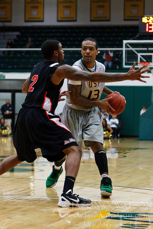 Dec 10, 2011; San Francisco CA, USA;  San Francisco Dons guard Rashad Green (13) is defended by Pacific Tigers guard Colin Beatty (2) during the first half at War Memorial Gym.  Mandatory Credit: Jason O. Watson-US PRESSWIRE