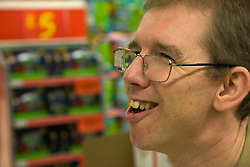 Portrait of a day Service user with learning disability whilst shopping at the supermarket,