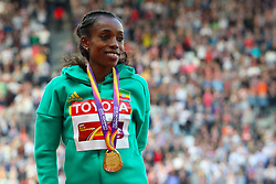 London, 2017 August 06. Almaz Ayana of Ethiopia, gold medalist in the women's 10,000m on the podium on day three of the IAAF London 2017 world Championships at the London Stadium. © Paul Davey.