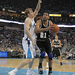 29 March 2009: San Antonio Spurs center Tim Duncan (21) drives past New Orleans Hornets forward Sean Marks (4) during a 90-86 victory by the New Orleans Hornets over Southwestern Division rivals the San Antonio Spurs at the New Orleans Arena in New Orleans, Louisiana.