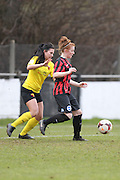 Fliss Gibbons protects the ball from Leigh Anne Robe during the Women's FA Cup match between Watford Ladies FC and Brighton Ladies at the Broadwater Stadium, Berkhampstead, United Kingdom on 1 February 2015. Photo by Stuart Butcher.