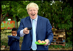 Image ©Licensed to i-Images Picture Agency. 18/07/2014. London, United Kingdom. Boris Johnson cooking eggs during his visit to Christ Church Primary school in Lambeth to promote healthier eating in schools. Picture by Andrew Parsons / i-Images