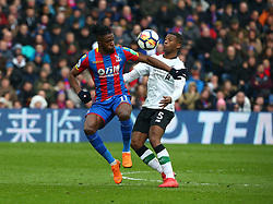 March 31, 2018 - London, Greater London, United Kingdom - Crystal Palace's Wilfried Zaha tussles with Liverpool's Georginio Wijnaldum.during the Premiership League  match between Crystal Palace and Liverpool at Wembley, London, England on 31 March 2018. (Credit Image: © Kieran Galvin/NurPhoto via ZUMA Press)