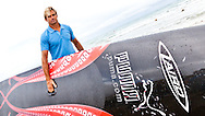 SPAIN, Alicante. 4th November 2011. Volvo Ocean Race. Surfer Laird Hamilton with his stand up paddle board designed by Juan Kouyoumdijan.