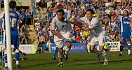 Picture by Ady Kerry/Focus Images Ltd.  .26/09/09.Norwich's Darel Russel and Adam Drury celebrate the injury time equaliser during their Coca-Cola League 1 game at the Priestfield Stadium, Gillingham, Kent
