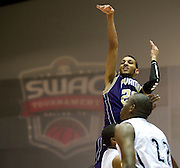 Jules Montgomery (20) of Prairie View A&M shoots the ball against Jackson State during the SWAC semi-finals at the Curtis Culwell Center in Garland on Friday, March 15, 2013. (Cooper Neill/The Dallas Morning News)