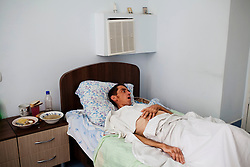 Jon Curu is coinfected with  MDR-TB and HIV and is being treated at the TB hospital in Vorniceni.  He is very weak and is unable to move or get out of bed.