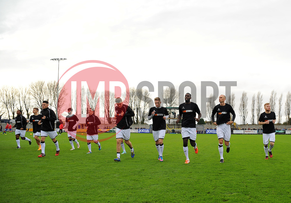 Weston Super Mare Team warm up before the match.   - Photo mandatory by-line: Nizaam Jones - Mobile: 07583 387221 - 08/11/2014 - SPORT - Football - Weston-super-Mare - Woodspring Stadium - WSM v Doncaster - Sport - Round One