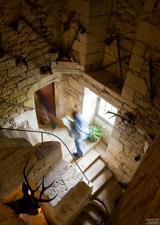Ghost-like images of tourists walking up the stairwell at La Maison Forte de Reignac, Tursac, Dordogne, France.  A framed print of this image received an Award of Excellence at the Pine Ridge Arts Council Juried Art Show (2010).