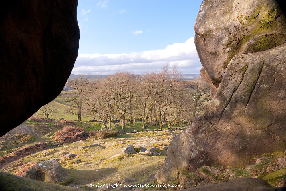 Derbyshire UK-8 March 2015: Looking over the Derbyshire countryside on 8 March from a cave in Robin Hood's Stride, near Elton