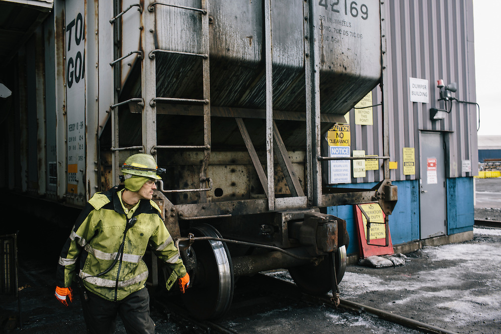 John Gay, exit operator, directs traffic and waits for the next train car to be unloaded so he can recouple them again at Consol Energy's Baltimore Terminal in Maryland on March 6, 2014. The facility has a throughput capacity of 15 million net tons per year.