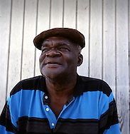 Abraham White, former farmer from Harris in the south who was rescued by the police on the day the 19 farmers were killed. Thousands were evacuated from their homes in the south of the island after it was abandoned after the 1995 and 1997 eruption of the Soufriere Hills volcano. The southern area which contained most of the farm land is still out of bounds to everyone except scientists..Photo©Steve Forrest/Workers Photos