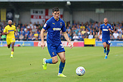 AFC Wimbledon midfielder Callum Reilly (33) dribbling during the EFL Sky Bet League 1 match between AFC Wimbledon and Wycombe Wanderers at the Cherry Red Records Stadium, Kingston, England on 31 August 2019.