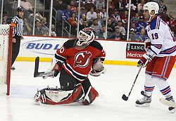 November 14, 2007; Newark, NJ, USA;  New Jersey Devils goalie Martin Brodeur (30) makes a save against New York Rangers center Scott Gomez (19) during the first period at the Prudential Center in Newark, NJ.