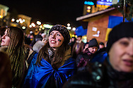 KIEV, UKRAINE - DECEMBER 3: Nastya Pryadko (C), a 22-year-old student from Kiev, attends an anti-government rally in Independence Square on December 3, 2013 in Kiev, Ukraine. Thousands of people have been protesting against the government since a decision by Ukrainian president Viktor Yanukovych to suspend a trade and partnership agreement with the European Union in favor of incentives from Russia. (Photo by Brendan Hoffman/Getty Images) *** Local Caption *** Nastya Pryadko