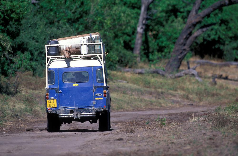 Africa, Botswana, Chobe Nat'l Park, (MR) Antonia Brand & Mike Horgan drive '73 Land Rover on safari along Chobe River