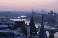 France Paris. 1st district. elevated view on the Conciergerie on ile de la cite a The spires of the Conciergerie rise above the Seine in Paris as seen from the Tribunal de Commerce. Across the river on Ile de la Cite is the Palais de Justice.