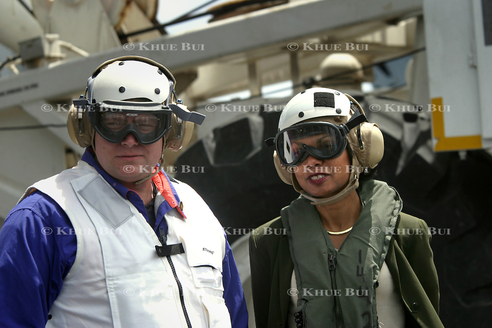 Deputy Chief of Staff Joe Hagin and Nationl Security Advisor Condoleezza Rice await the arrival of President Bush on flight deck of the aircraft carrier USS Abraham Lincoln after arriving via a US Navy S-3B Viking Thursday, May 1, 2003, in the Pacific Ocean.  Bush traveled to the aircraft carrier USS Abraham Lincoln to meet with returning sailors and to announce and end to 'major combat operations' in Iraq...Photo by Khue Bui