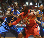 Mississippi's Chris Warren (12) is defended by Memphis' Willie Kemp (5) during an NIT game in Oxford, Miss. on Friday, March 19, 2010.