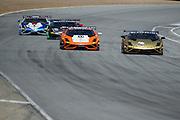 May 2-4, 2014: Laguna Seca Raceway. #18 Brett David, Avid Motorsport, Lamborghini of Miami battles #77 Joe Courtney, Peter Argetsinger, Musante Motorsport, Lamborghini Boston