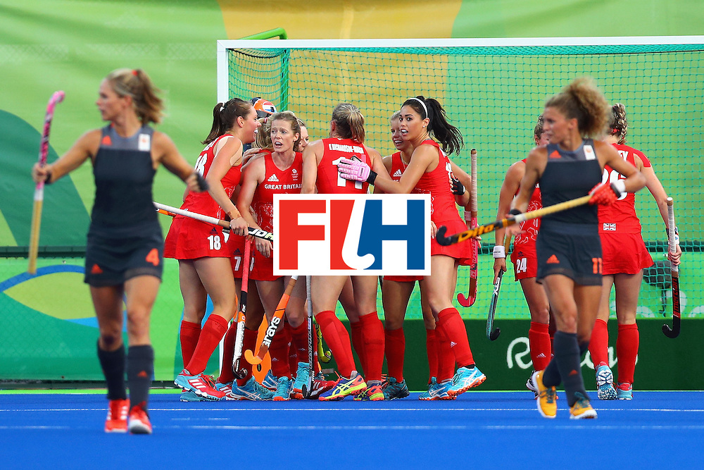 RIO DE JANEIRO, BRAZIL - AUGUST 19:  Lily Owsley #26 of Great Britain celebrates with teammates after scoring a goal against Netherlands during the Women's Gold Medal Match on Day 14 of the Rio 2016 Olympic Games at the Olympic Hockey Centre on August 19, 2016 in Rio de Janeiro, Brazil.  (Photo by Tom Pennington/Getty Images)
