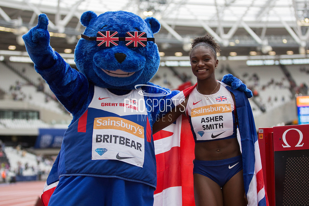 Dina Asher-Smith of Great Britain after the Women's 100m with Britbear Mascot at the Sainsbury's Anniversary Games at the Queen Elizabeth II Olympic Park, London, United Kingdom on 25 July 2015. Photo by Phil Duncan.