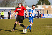 Hassocks' Chloe John is shadowed by Charlotte Owen during the FA Women's Sussex Challenge Cup semi-final match between Brighton Ladies and Hassocks Ladies FC at Culver Road, Lancing, United Kingdom on 15 February 2015. Photo by Geoff Penn.