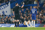 Referee Christopher Kavanagh signals to the Chelsea bench as Chelsea defender David Luiz (30) lies on the floor following a challenge during the Premier League match between Chelsea and West Ham United at Stamford Bridge, London, England on 8 April 2019.