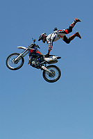 Jul 01, 2003; Anaheim, California, USA; Moto X star athlete RONNIE RENNER executing a tremendous stunt hands free with a full sized motobike at the opening of Disney's California Adventure &quot;X Games Experience&quot;.  Disney park has built two X-Arena's specifically for this 41 day event highlighting extreme sports for the launch of the 2003 ESPN X Games.<br />