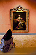 Woman admiring artwork in a museum, Thyssen-Bornemisza, Museum, Madrid, Spain
