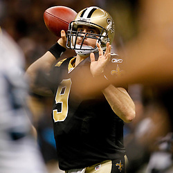 January 1, 2012; New Orleans, LA, USA; New Orleans Saints quarterback Drew Brees (9) throws against the Carolina Panthers during the second half of a game at the Mercedes-Benz Superdome. The Saints defeated the Panthers 45-17. Mandatory Credit: Derick E. Hingle-US PRESSWIRE