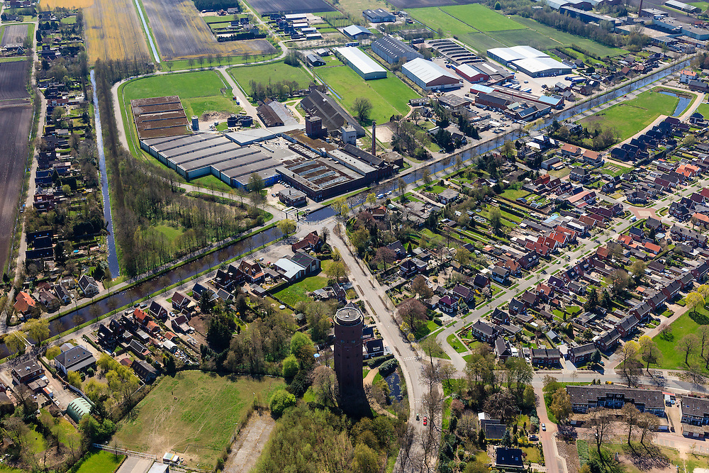 Nederland, Groningen, Gemeente Pekela,  01-05-2013; Oude Pekela, links watertoren aan de Winschoterweg en aan de andere kant van het Pekelderdiep de oude strokartonfabriek Aastroom (Aa-stroom).<br /> Small provincial town, known for the production of strawboard (northeast Holland).<br /> luchtfoto (toeslag op standard tarieven);<br /> aerial photo (additional fee required);<br /> copyright foto/photo Siebe Swart