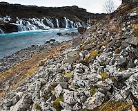 Hraunfossar falls detail, Borgarfjörður, West Iceland. The waterfalls pour into the Hvítá river from ledges of less porous rock in the lava.